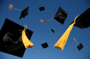 cap and gowns in air