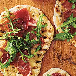 Grilled Pizza with Prosciutto, Arugula, and Lemon Photo: Anna Williams; Styling: Pam Morris